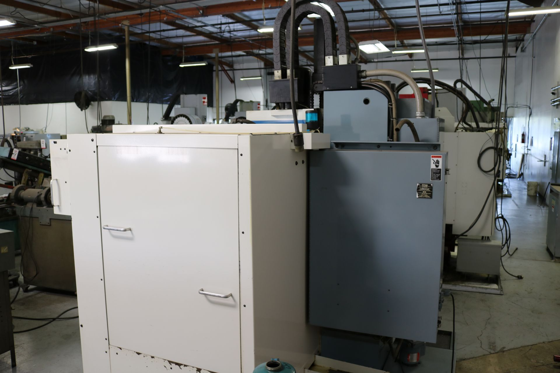 "Lot 8 - 1992 FADAL 3016 CNC VERTICAL MACHINING CENTER, TRAVELS: 30"" X 16"" X 20"", 39"" X 16"" TABLE, 10000"