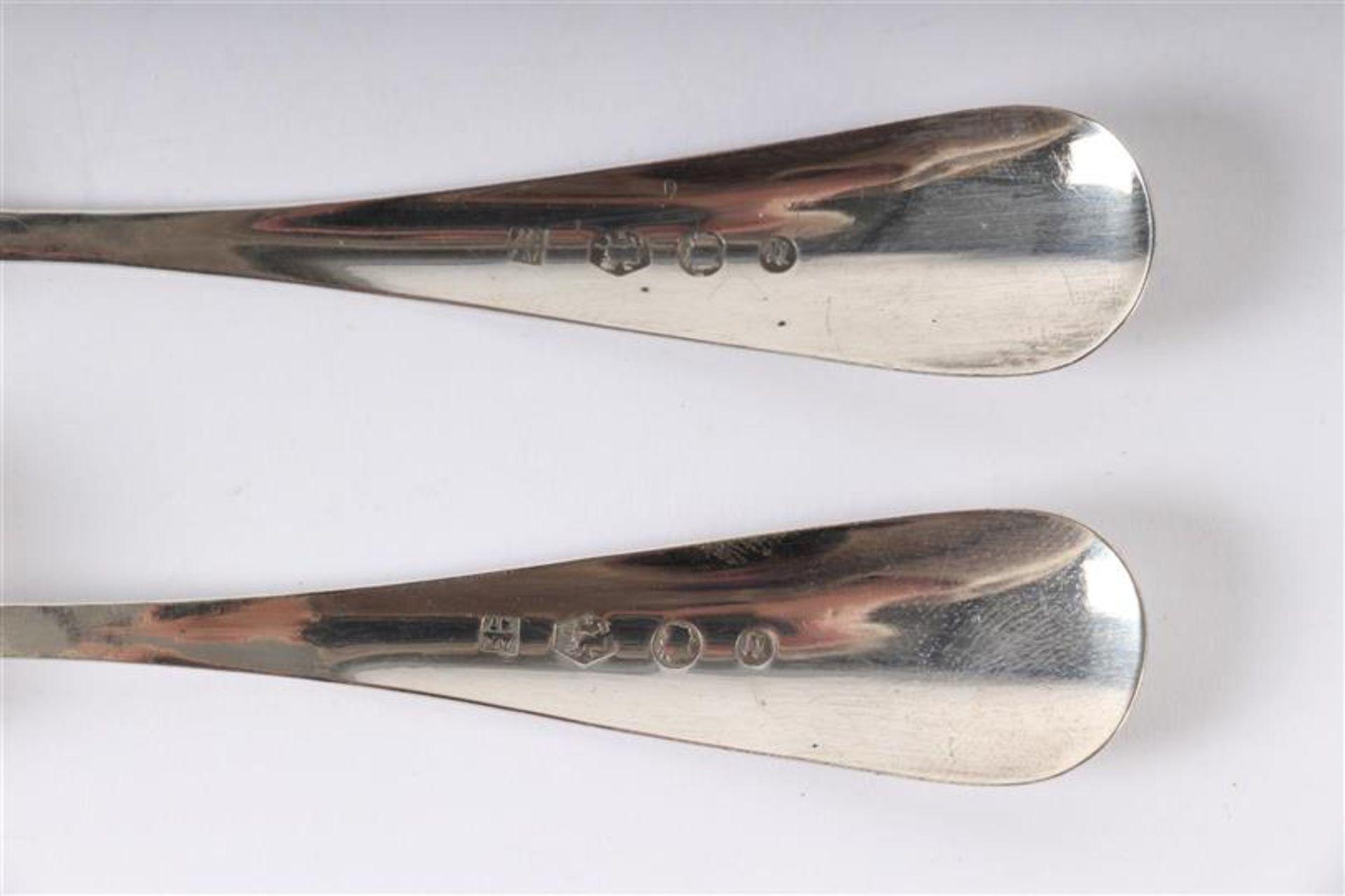 Los 54 - Diverse lepeltjes, waaronder zilver Hollands gekeurd, ca. 31 stuks.