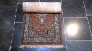 Kavel bestaande uit vier diverse tapijtjes en een loper.