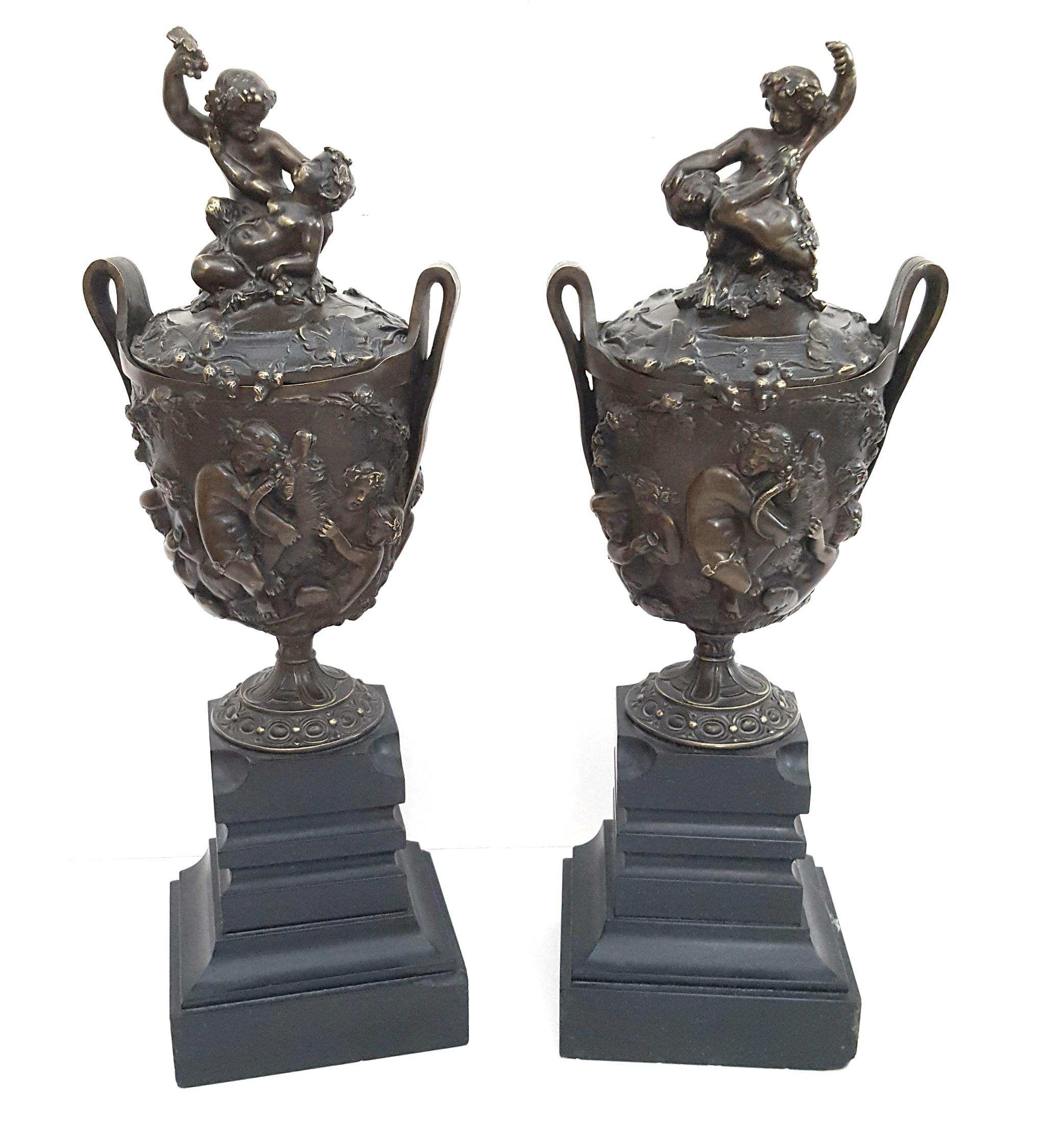Lot 10 - Antique 2 Bronze Lidded Vases On Slate Plinths Depicting Fauns Ram Lion Bacchus & Grape Vines