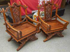 Zwei Armlehnstühle, Indonesien, 20. Jahrhundert, Tropenholz mit aufwändiger Schnitzarbeit. H. ca.