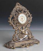 Tischuhr, Frankreich, im Stil des Historismus, Bronze o. Messing, Wecker-Aufzugswerk. H.ca. 21 cm,