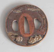 Tsuba, Japan, wohl späte Edo-Periode, Kupfer mit Goldauflage. Mit floraler Motivik(Blütenzweige).