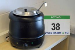 A BUFFALO Electric Soup Kettle with a Ladle