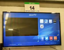 A JVC 50 inch LCD Smart Television with Wall Bracket and Hand Held Remote Control