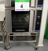 A BLUE SEAL Turbo Fan Model E31 D4 Stainless Steel Electric Oven on Castor mounted Stand