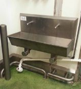 A Stainless Steel 2-Station Knee Operated Sink. (A Method Statement is Required Prior to Removal