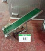 An Approx. 200mm Wide x 1100mm Long Portable Inclined Polypropylene Slatbelt Transfer Conveyor (