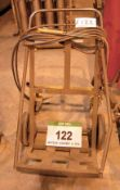 A Twin Gas Bottle Trolley, Cutting Torch and Regulator Hoses