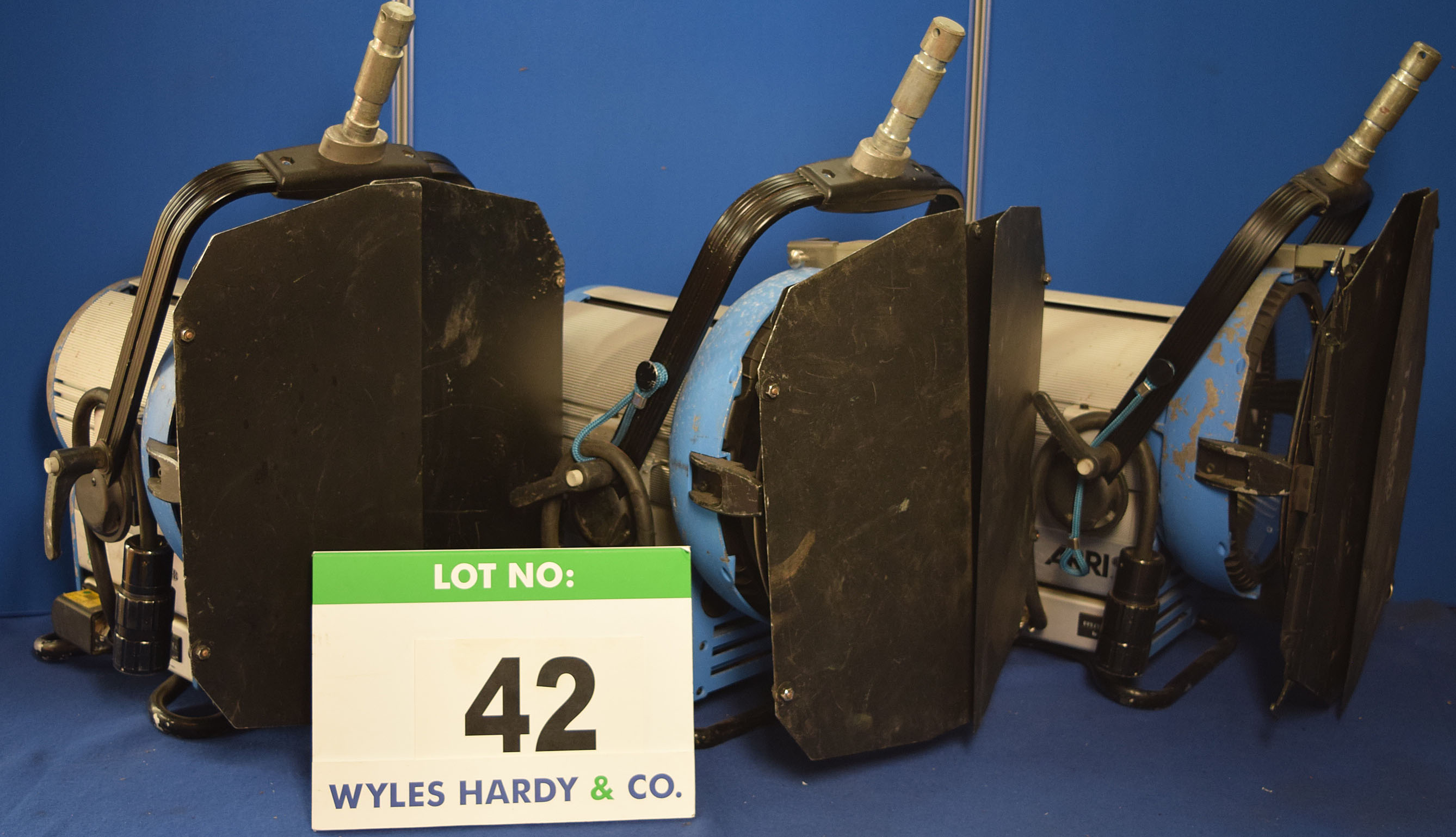Lot 42 - Three ARRI M18 1800W Lights each with fitted Barn Doors and Stirrup Mounts. Recorded Hours: 670