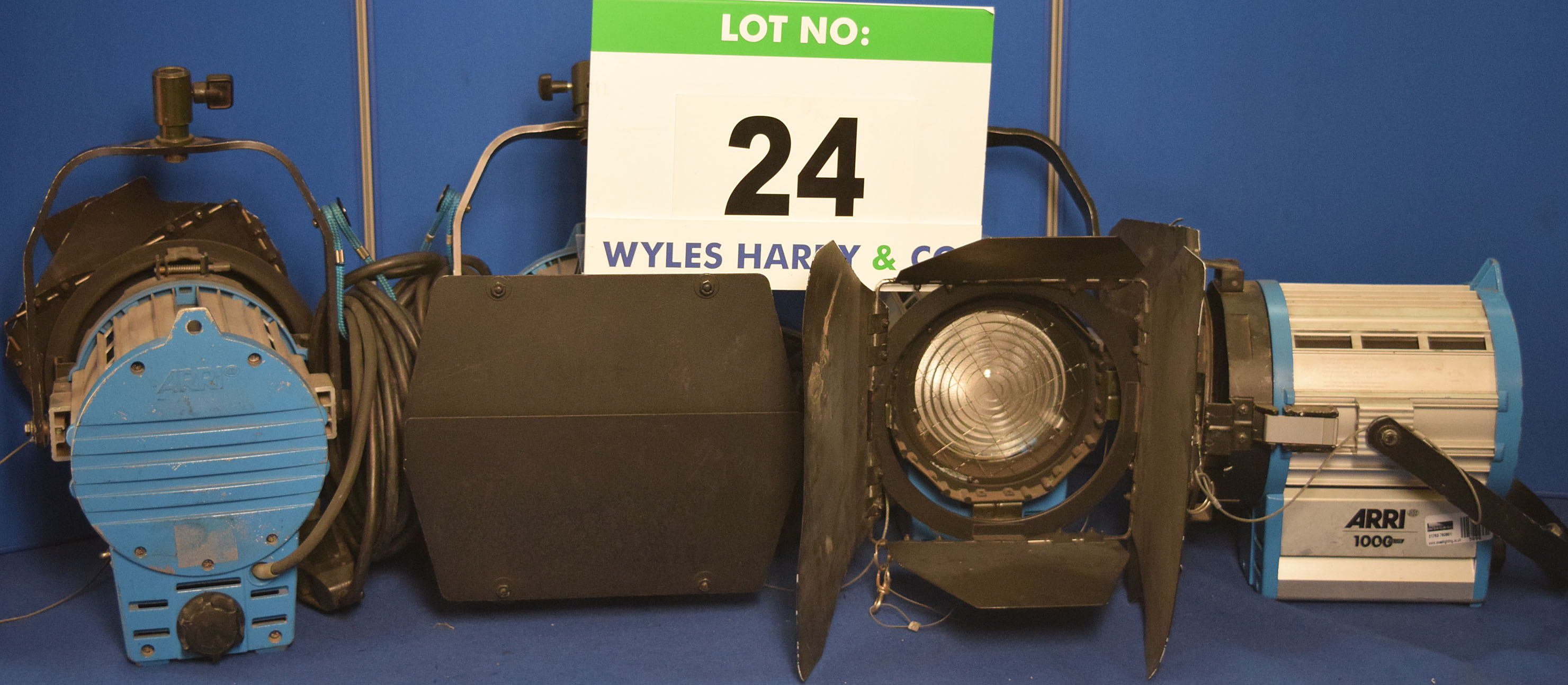 Lot 24 - Four ARRI 1000 Plus 1000W Lights each with fitted Barn Doors, Stirrup Mount and Switched Power Feed