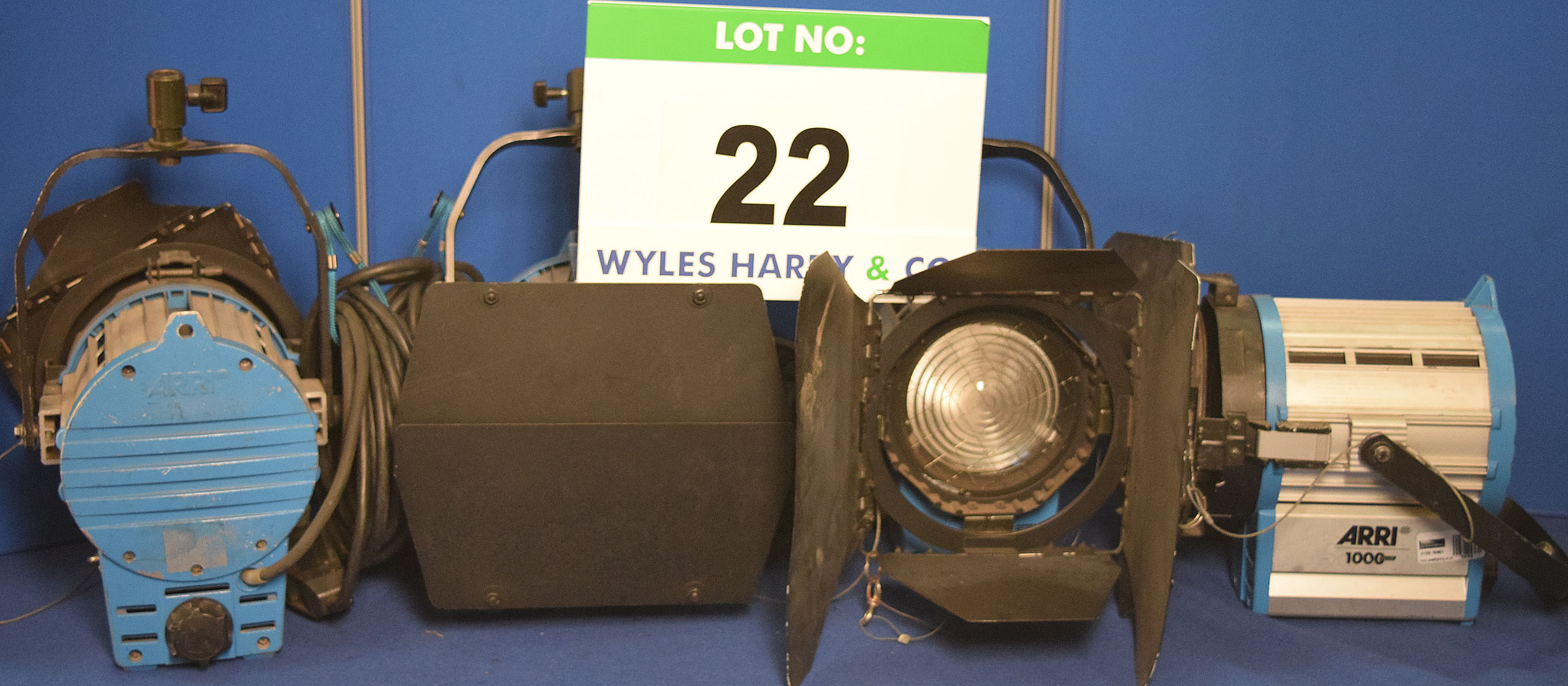 Lot 22 - Four ARRI 1000 Plus 1000W Lights each with fitted Barn Doors, Stirrup Mount and Switched Power Feed
