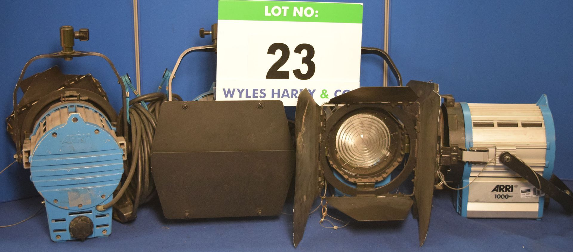 Lot 23 - Four ARRI 1000 Plus 1000W Lights each with fitted Barn Doors, Stirrup Mount and Switched Power Feed