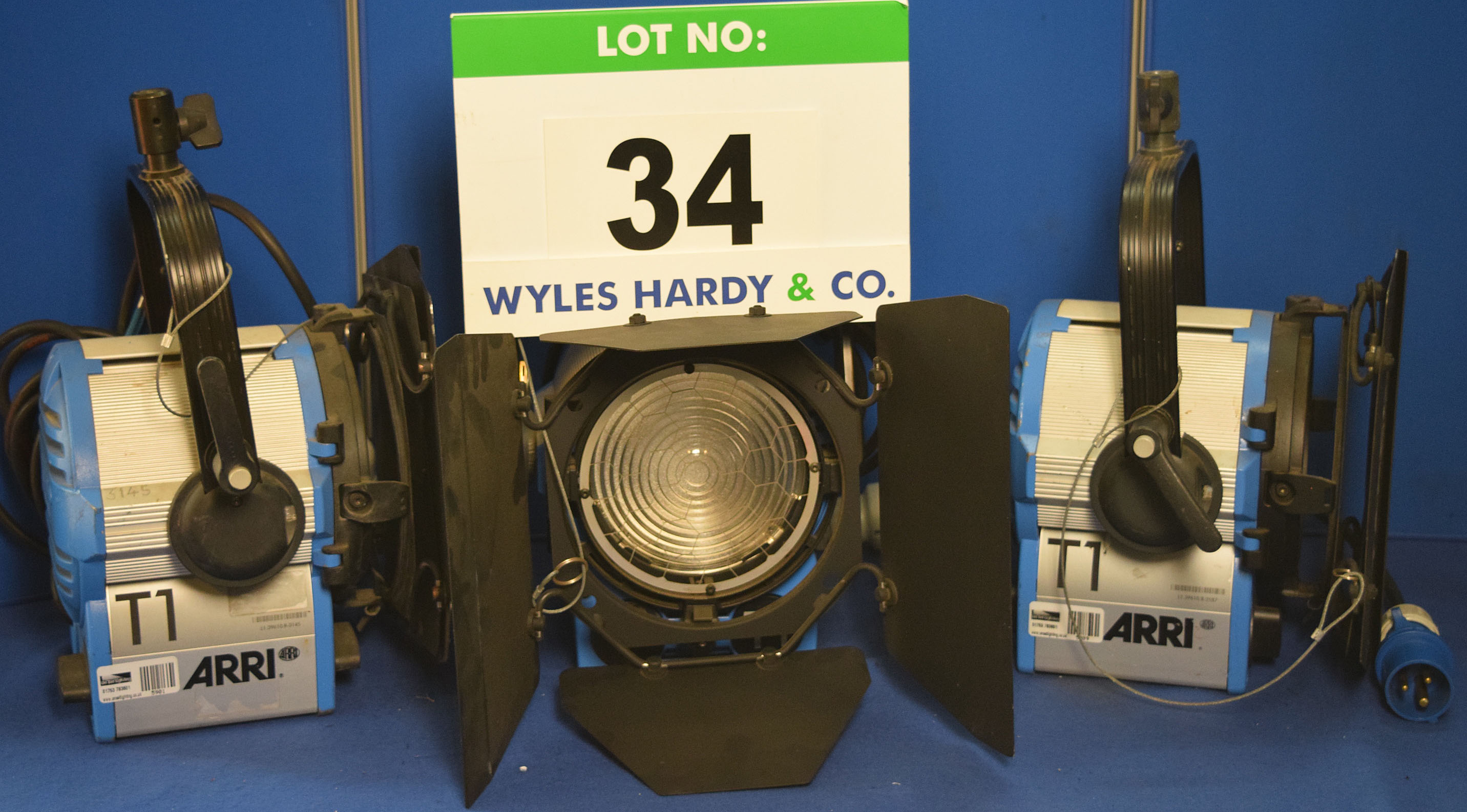 Lot 34 - Three ARRI T1 1000W Lights each with fitted Barn Doors, Stirrup Mount and Switched Power Feed