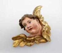 Holzfigur - Putte - 18. Jahrhundert Polychrom- und goldstaffierte Figur, Spuren von früherem