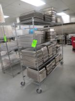 Lot 43 - LOT OF ASSORTED STAINLESS STEEL TRAYS WITH MOBILE METRO RACK