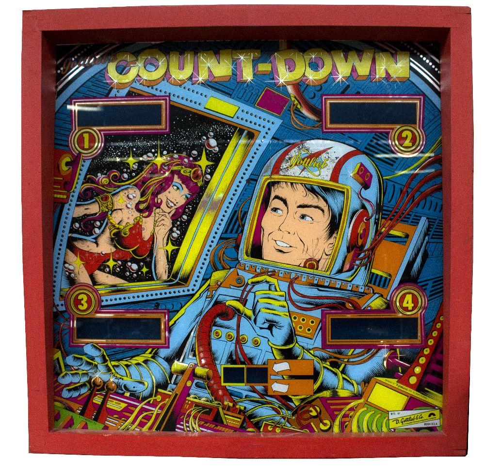 Lot 31 - A Gottlieb 'Count-Down' pinball machine headboard circa 1979 or early 1980s, approx 65 x 66cm,