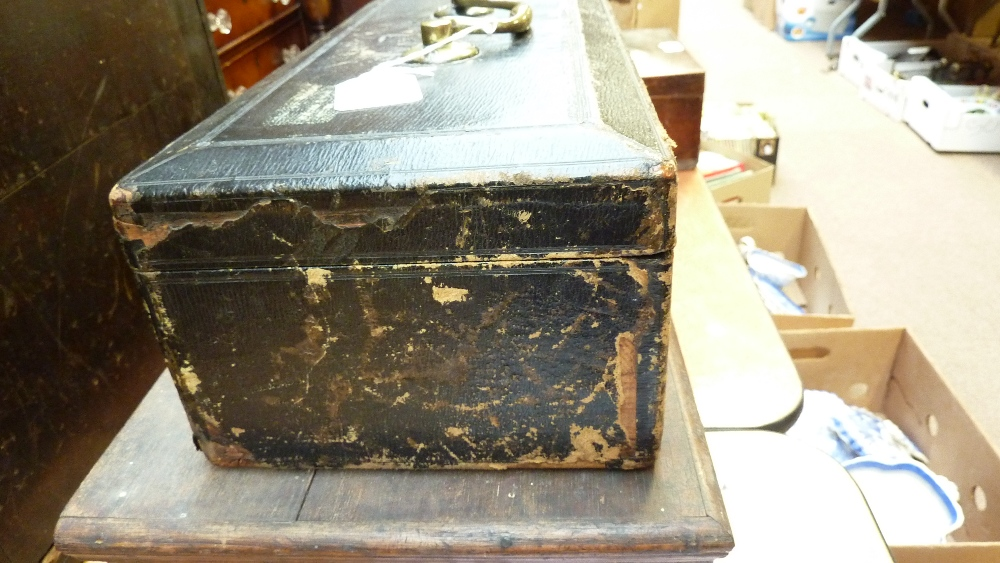 Lot 39A - A 19th century leather clad lidded box inscribed 'Lord Privy Seal', with large brass carrying handle