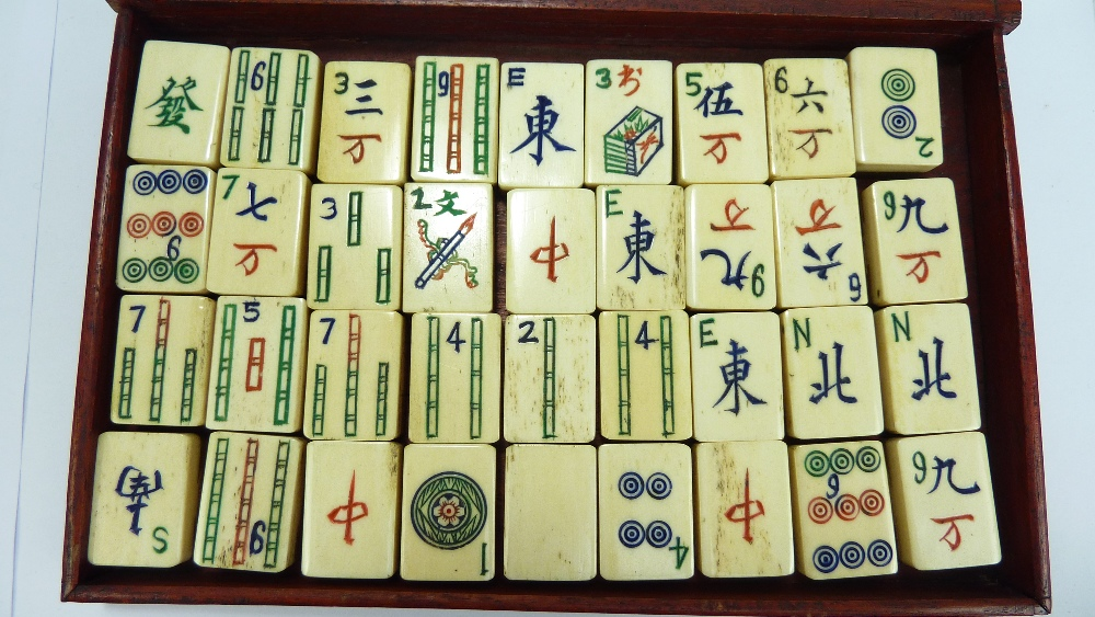 Lot 30 - A cased Mahjong set with bone tiles.Additional InformationGeneral wear and tear to the case. The