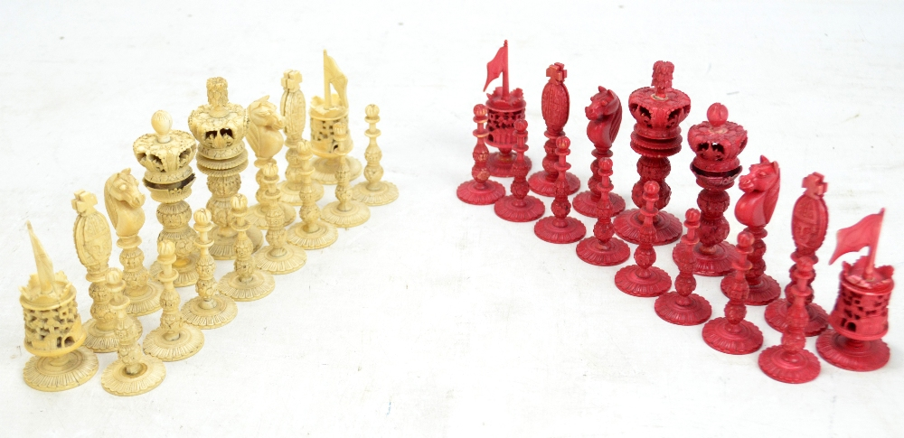 Lot 32 - A late 19th century Chinese carved and stained ivory chess set, height of king 9.3cm.Additional