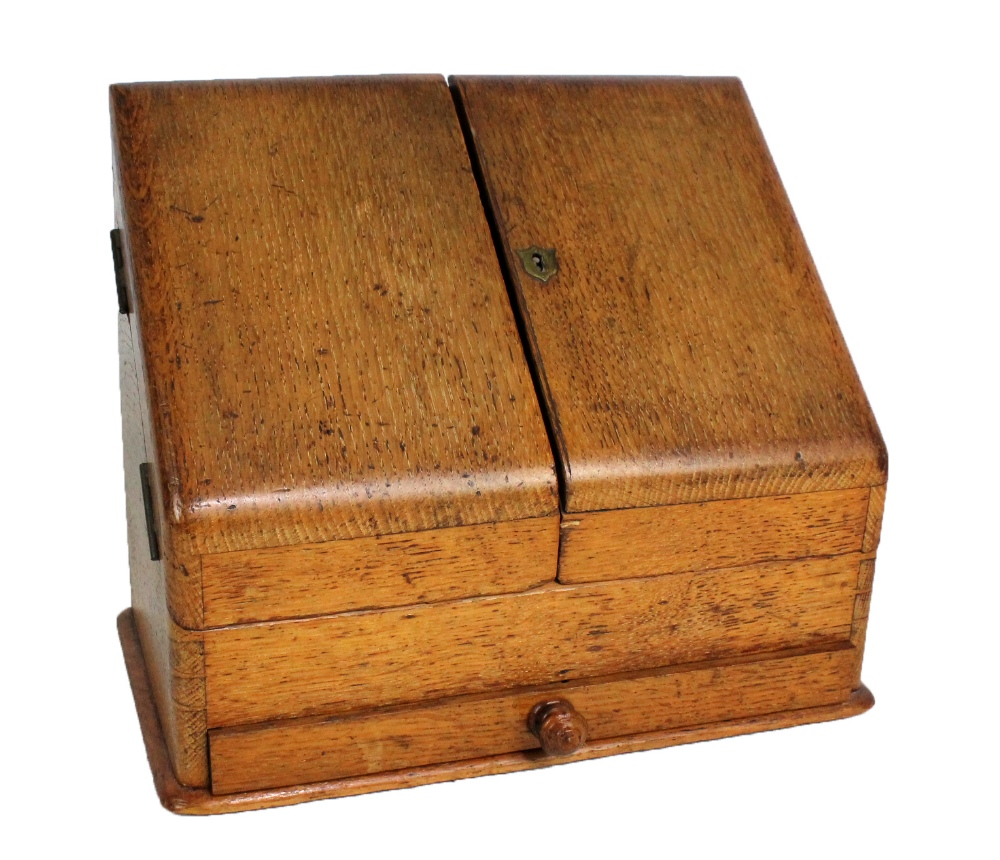 Lot 35A - PAWSON & BRAILSFORD; a late Victorian oak stationery cabinet with hinged doors enclosing a sectioned