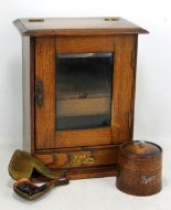 Lot 35 - An oak smoker's cabinet with tobacco jar and single cased pipe.