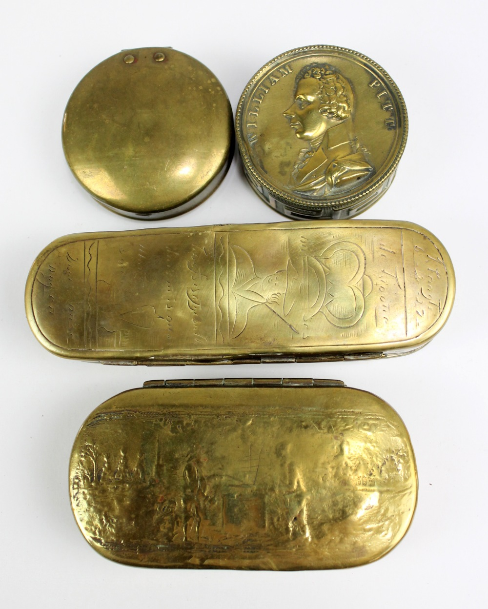 Lot 16 - Two 18th century Dutch brass tobacco boxes, both with heavily rubbed decoration, a circular