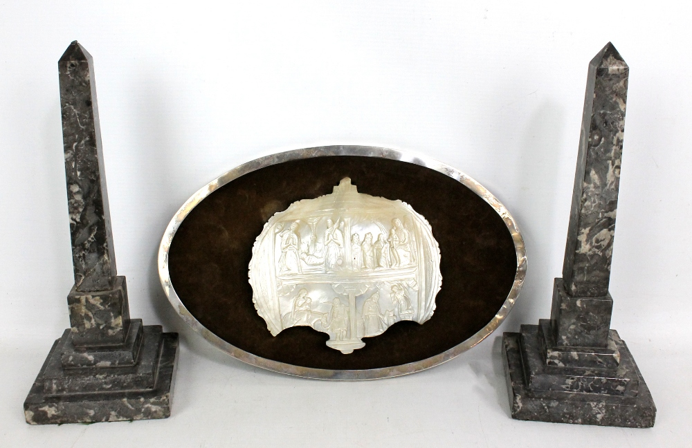 Lot 10 - An early 20th century oval silver frame mounted with part of a carved mother of pearl plaque,