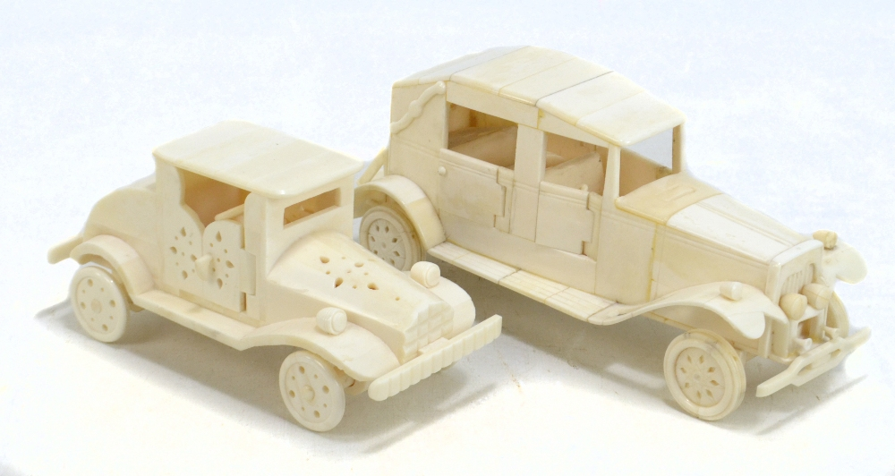 Lot 6 - Two modern Indian bone models of vintage cars, the larger length 24cm (one af) (2).