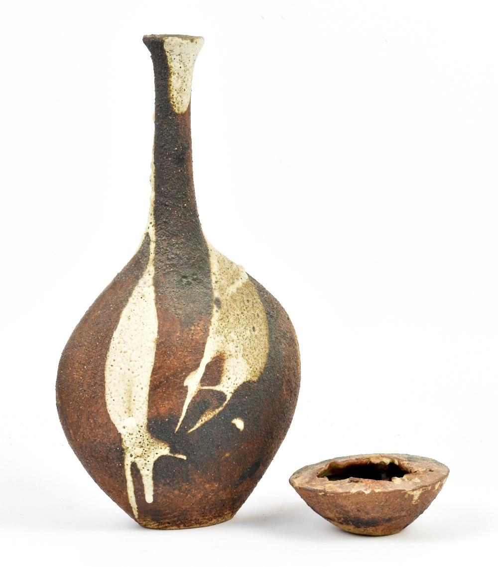 Lot 117 - ROBERT FOURNIER (1915-2008); a stoneware bottle of flattened form, impressed RF mark, height 31cm,