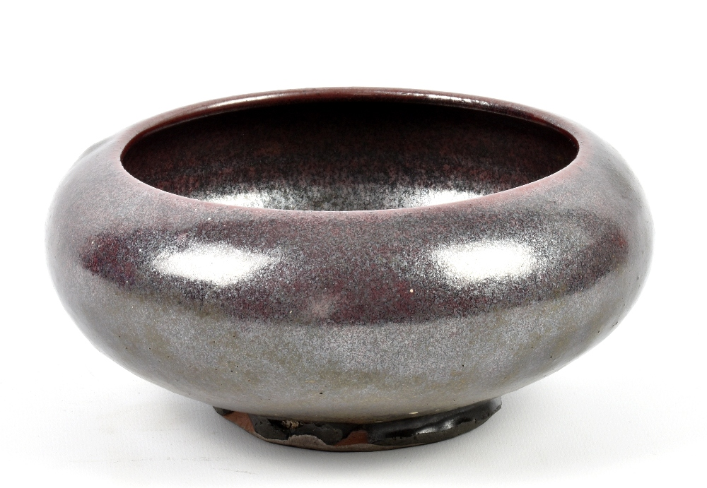 Lot 84 - BERNARD LEACH (1887-1979) for Leach Pottery; an early stoneware footed bowl covered in metallic