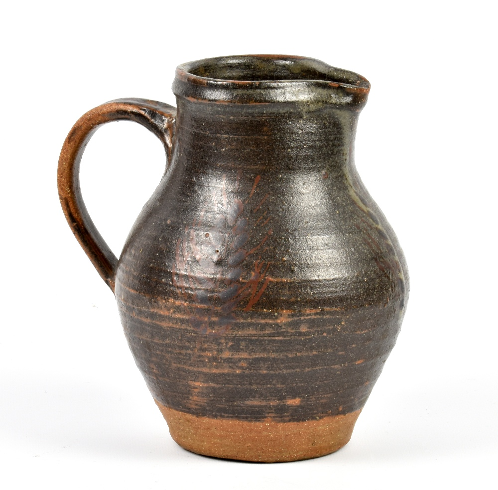 Lot 92 - Attributed to HEBER MATHEWS (1907-1959); a stoneware jug, iron glaze with iron decoration, incised