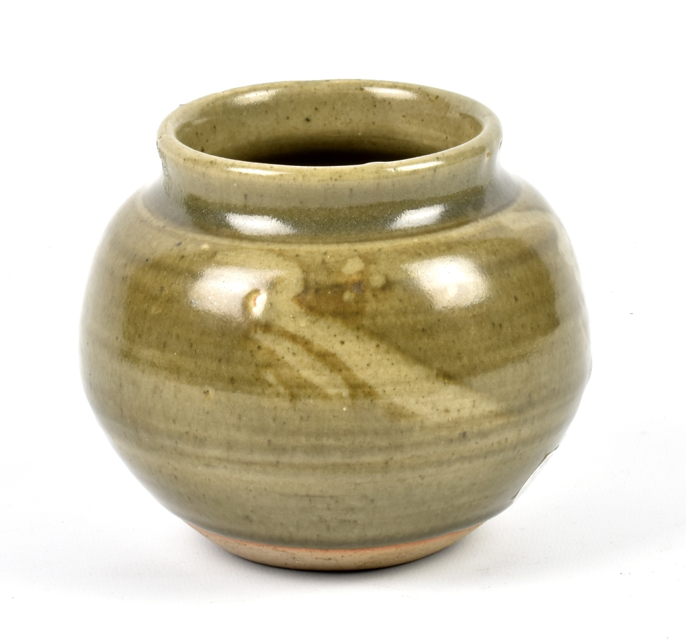 Lot 121 - GEOFFREY WHITING (1919-1988) for Avoncroft Pottery; a stoneware vase covered in green glaze,