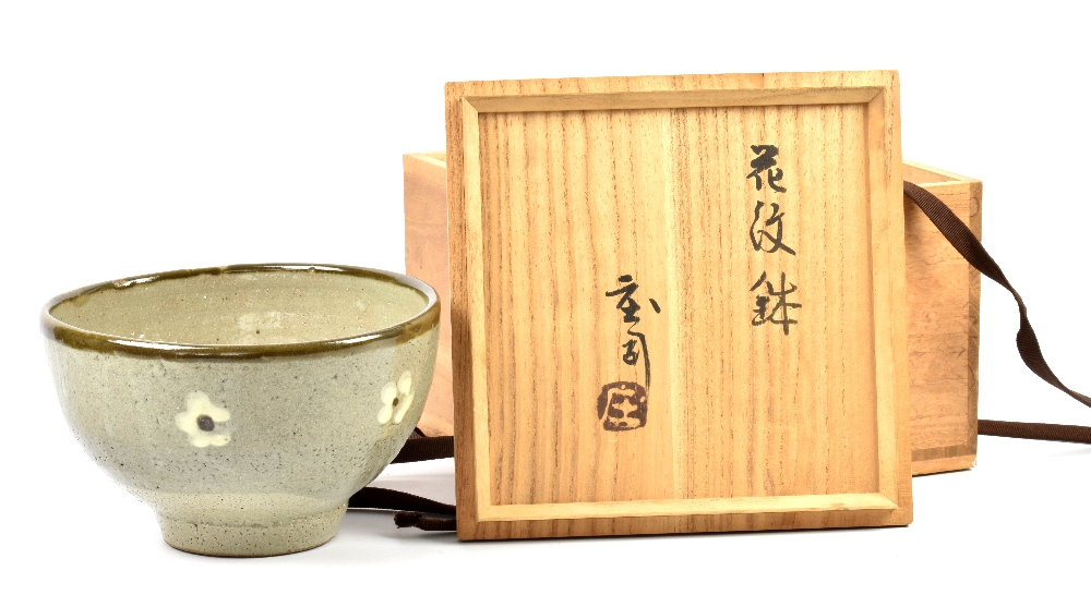 Lot 86 - SHOJI HAMADA (1894-1978); a stoneware footed bowl decorated with white flowers on grey ground,