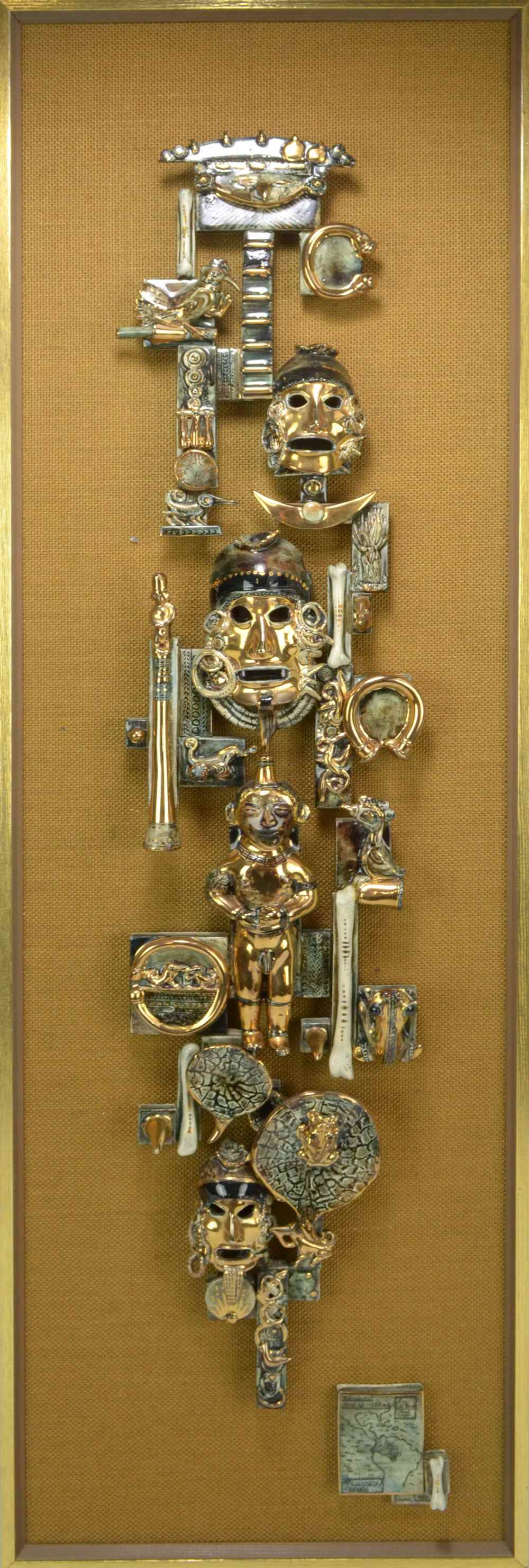 Lot 82 - BOWEN WILLIAMS; an abstract wall plaque depicting South American masks and artifacts on a hessian