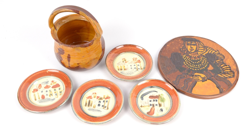 Lot 126 - MARY WONDRAUSCH (1923-2016); a slipware basket, Elizabethan plaque and four small plates, pottery