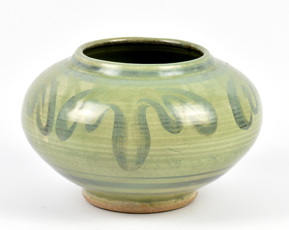 Lot 101 - PERCY BROWN (1911-1996); a stoneware squat vase covered in green glaze with cobalt decoration,