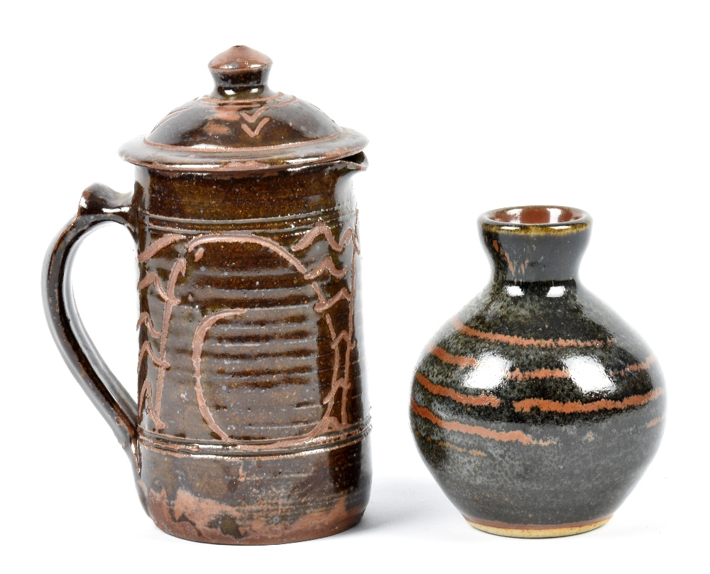 Lot 90 - Wenford Bridge Pottery; a stoneware jug and cover, tenmoku glaze with incised decoration,
