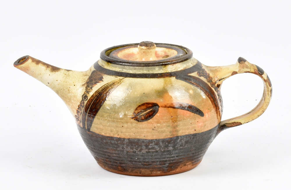 Lot 115 - RAY FINCH (1914-2012) for Winchcombe Pottery; a slipware teapot, galena and iron glaze, impressed