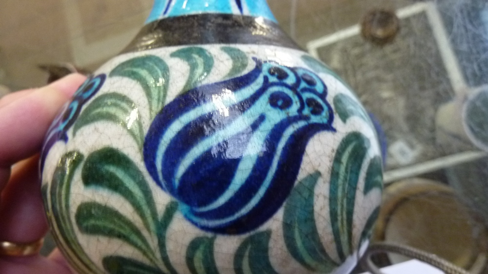 Lot 80 - WILLIAM DE MORGAN; a Persian inspired vase with five stylised tulips painted in blue on a cream