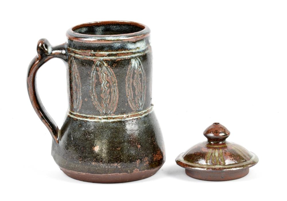 Lot 132 - LADI KWALI (1925-1984) for Abuja Pottery; a stoneware tankard and an associated lid, impressed LK