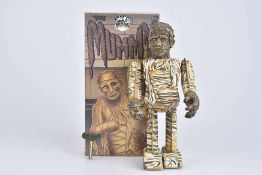 TM The Mummy, Made in Japan, Blech/ Kunststoffkopf, lithographiert, H 22 cm, Uhrwerk ff, Z 1, Okt.