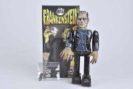 TM Frankenstein, Made in Japan, Blech/ Kunststoffkopf, lithographiert, H 24 cm, Uhrwerk ff., Z 1,