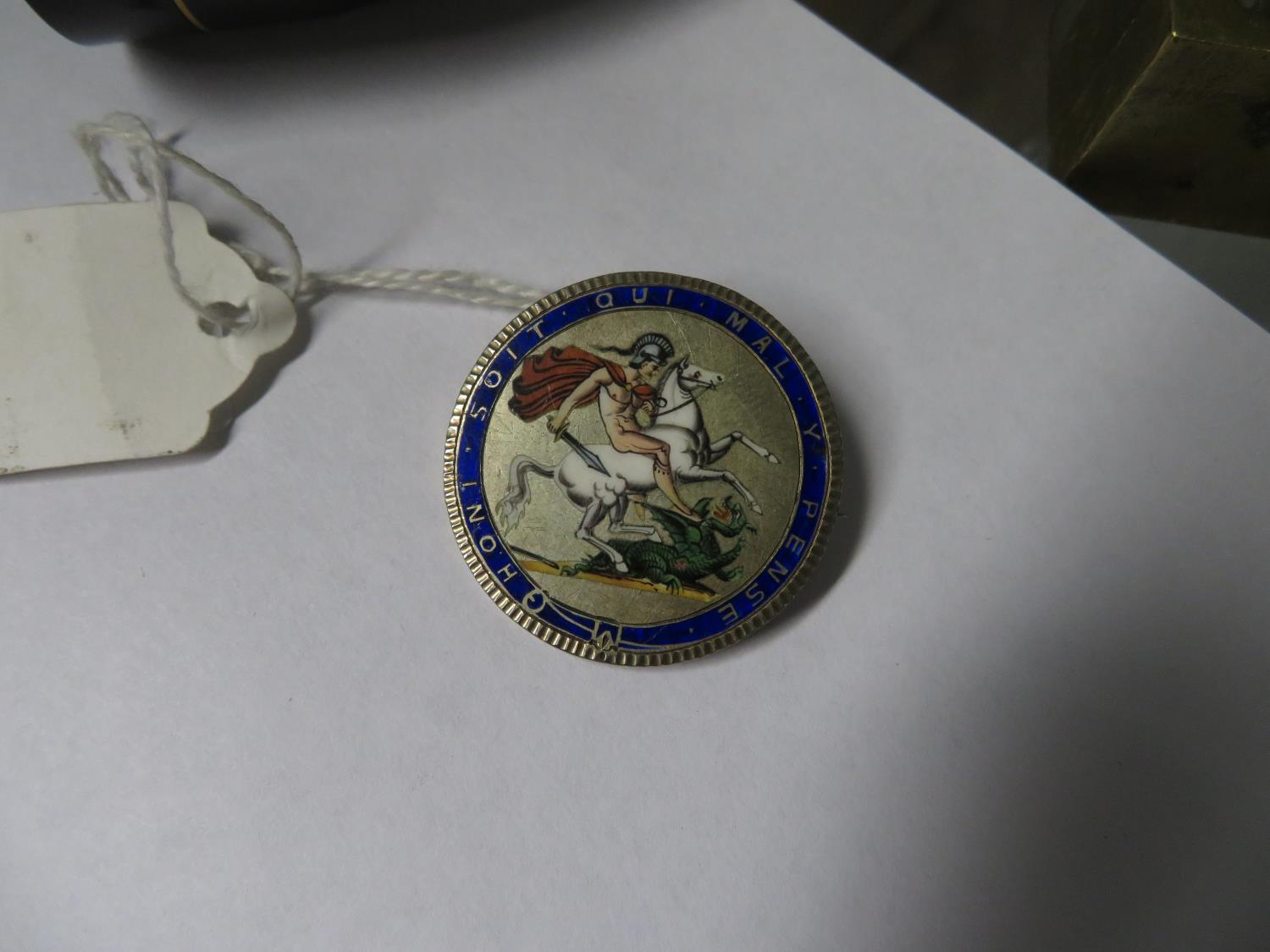 Lot 53 - Georgian enamelled silver coin turned into brooch