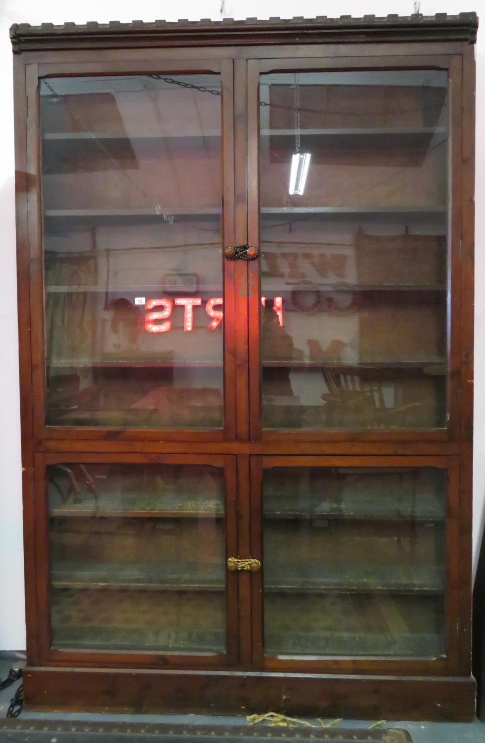 Lot 15 - 6' x 8' glass fronted bookshelf
