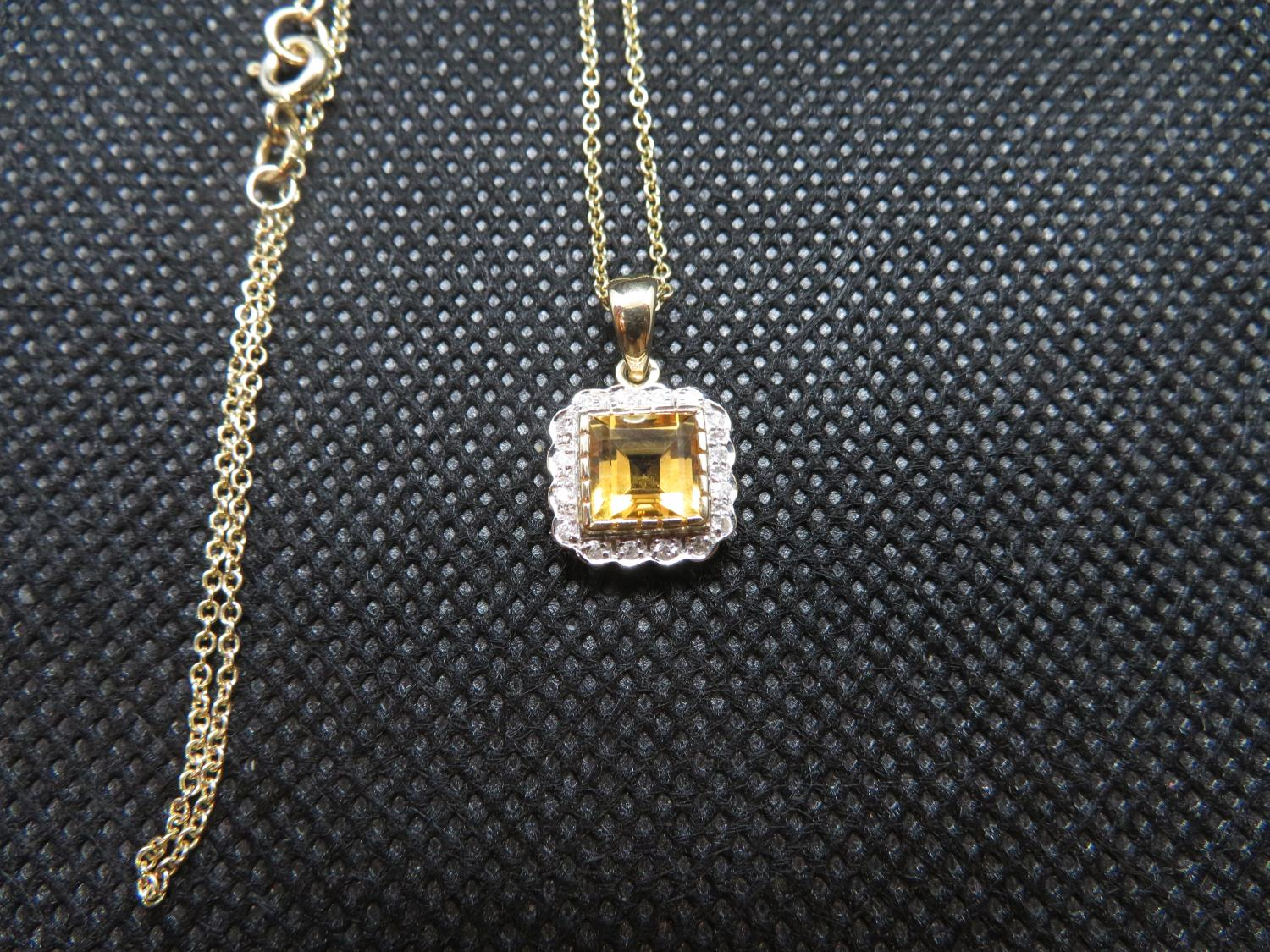 "Lot 1 - 9ct gold citrine and diamond pendant on 18"" 9ct gold chain"
