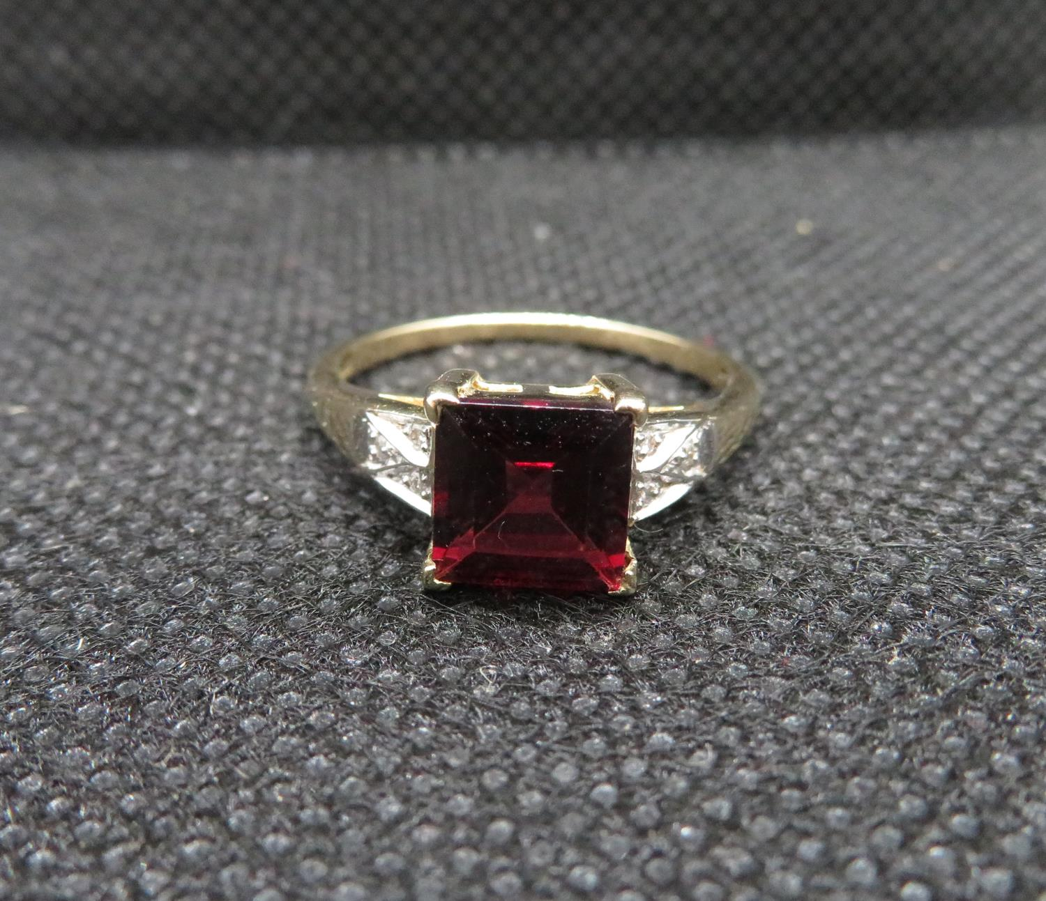 Lot 4 - 9ct gold and garnet diamond ring fully HM
