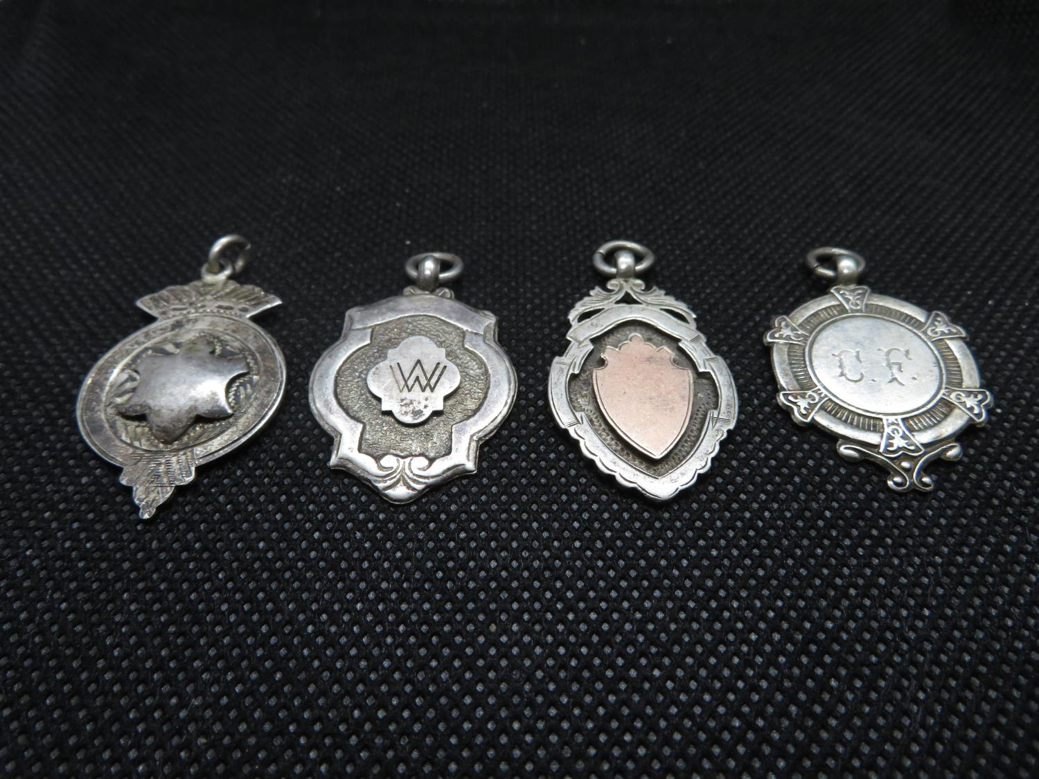 Lot 58 - 4 antique silver Albert watch medals all HM 22g