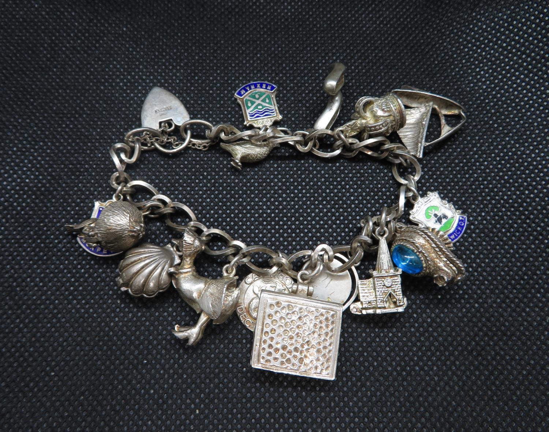 Lot 16 - Vintage silver figaro link bracelet with 15 charms including Jemima Puddleduck Birmingham 1972 55