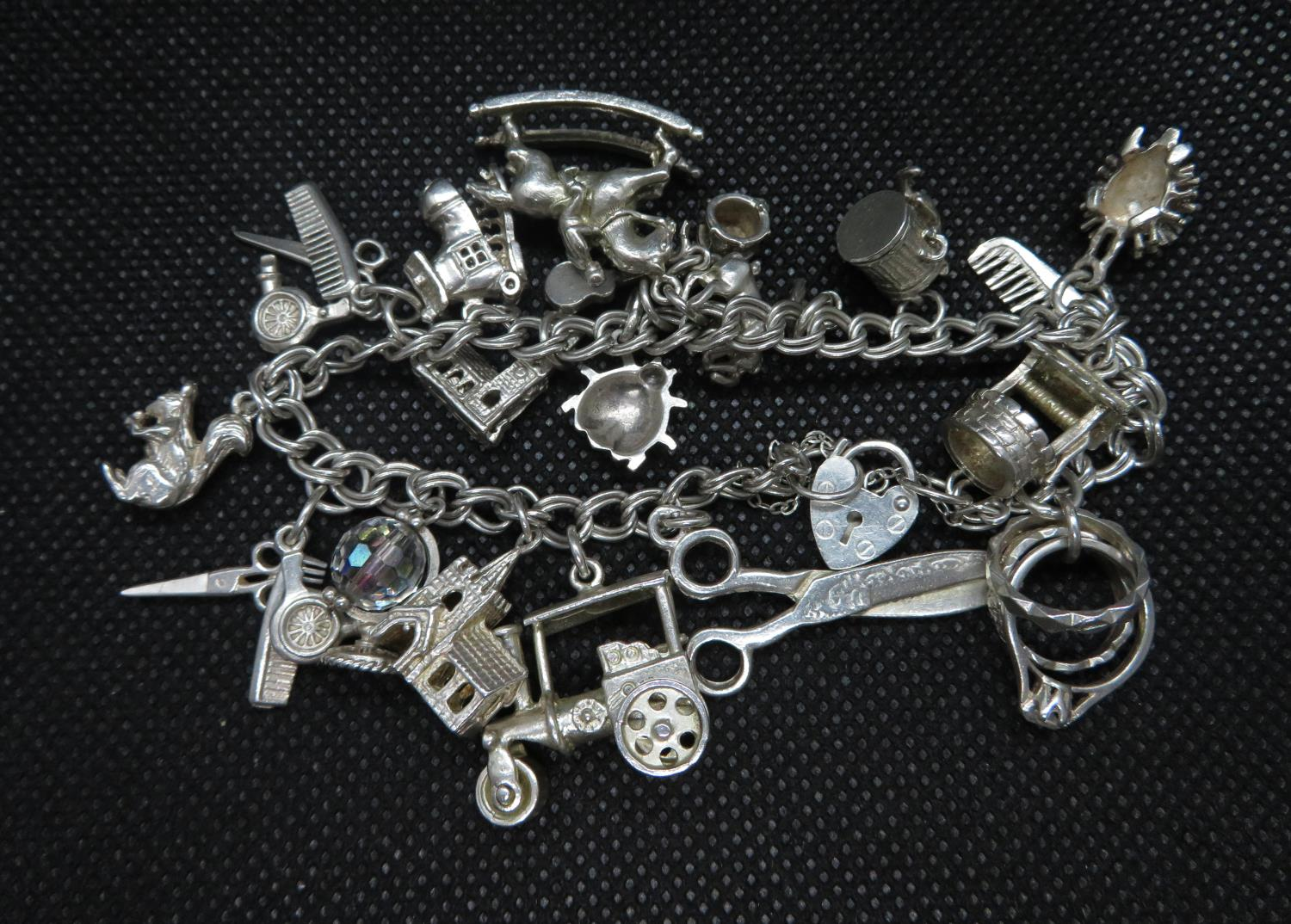 Lot 17 - Vintage silver double link charm bracelet with padlock and chain approx 20 charms HM Birmingham 1988